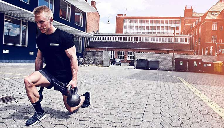 Walking kettlebell lunges